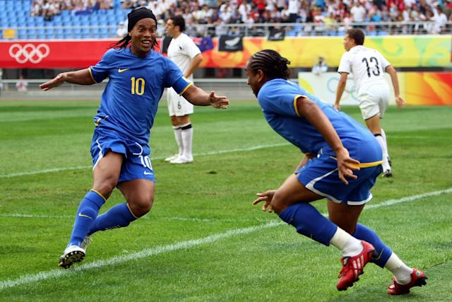 SHENYANG, CHINA - AUGUST 10: Ronaldinho (L) of Brazil celebrates with team mate Anderson, who scored the first goal, during the Men's First Round Group C match between New Zealand and Brazil in Shenyang Olympic Stadium on Day 2 of the Beijing 2008 Olympic Games on August 10, 2008 in Shenyang, China. (Photo by Lars Baron/Bongarts/Getty Images)