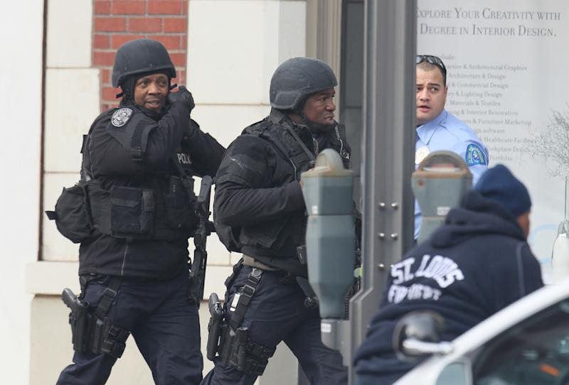 Police respond to the report of a shooting at Stevens Institute of Business and Arts in St. Louis on Tuesday, Jan. 15, 2013.  Police say a gunman entered the school and shot a person in the chest, then shot himself.  Everyone inside the building was evacuated, though police were checking the school to make sure the building was empty.  The conditions of the shooting victims were not immediately known.  (AP Photo/St. Louis Post-Dispatch, David Carson)