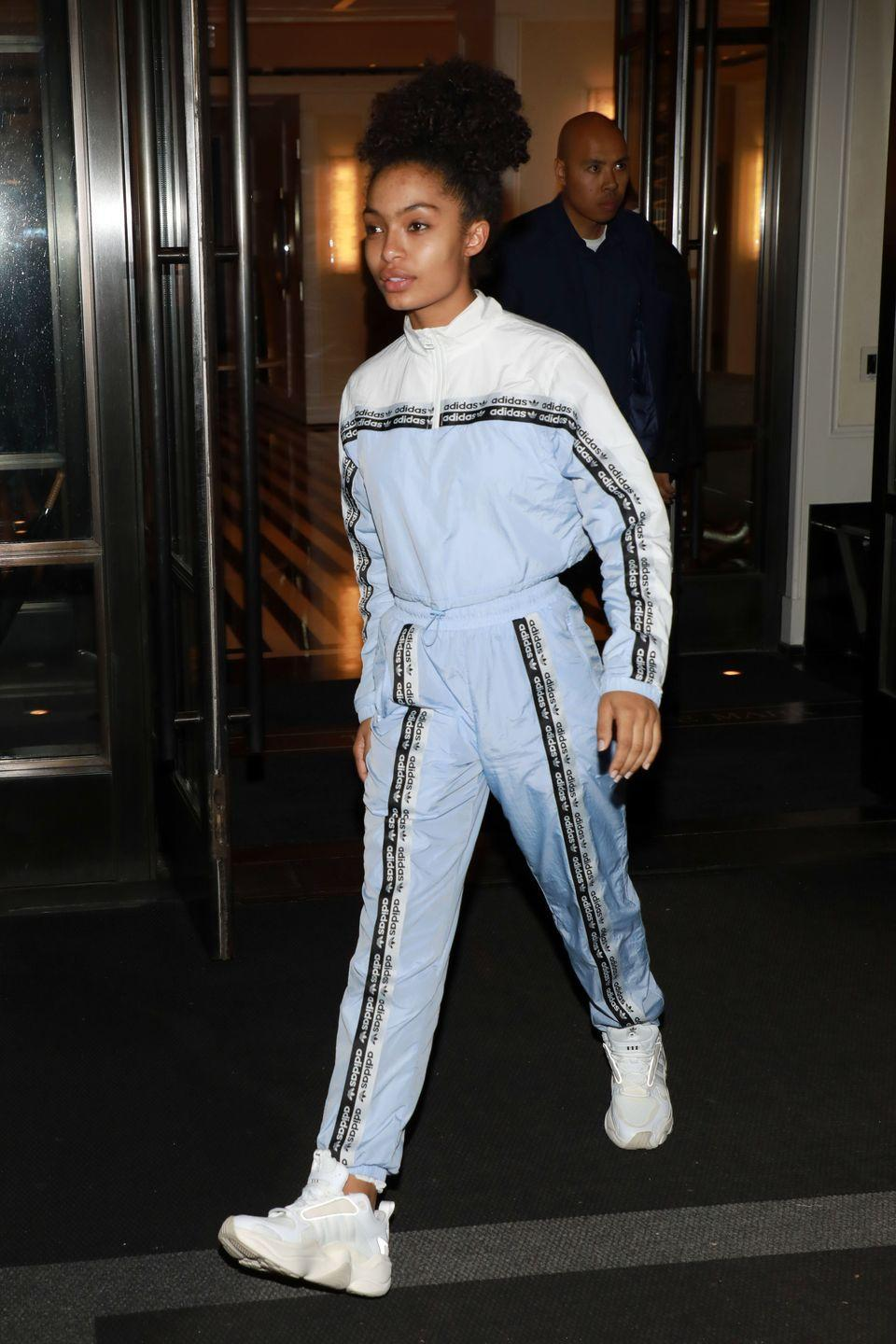 """<p>For some reason, a matching tracksuit just feels more put-together than regular sweatpants. A sleek top knot is the perfect <a href=""""https://www.seventeen.com/beauty/celeb-beauty/advice/g460/back-to-school-beauty-inspiration/"""" rel=""""nofollow noopener"""" target=""""_blank"""" data-ylk=""""slk:back to school hairstyle"""" class=""""link rapid-noclick-resp"""">back to school hairstyle</a> to go along with it. </p>"""