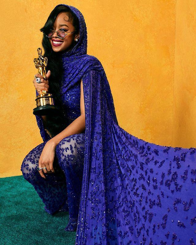 """<p>The first-time winner (who's already <a href=""""https://people.com/movies/oscars-2021-her-halfway-to-egot-after-best-original-song-win/"""" rel=""""nofollow noopener"""" target=""""_blank"""" data-ylk=""""slk:halfway to achieving the EGOT)"""" class=""""link rapid-noclick-resp"""">halfway to achieving the EGOT)</a> proudly posed with her <a href=""""https://people.com/movies/oscars-2021-her-wins-best-song-at-the-academy-awards/"""" rel=""""nofollow noopener"""" target=""""_blank"""" data-ylk=""""slk:Oscar for Best Music (Original Song)"""" class=""""link rapid-noclick-resp"""">Oscar for Best Music (Original Song)</a> for """"Fight For You"""" from <em>Judas and the Black Messiah</em>.</p>"""