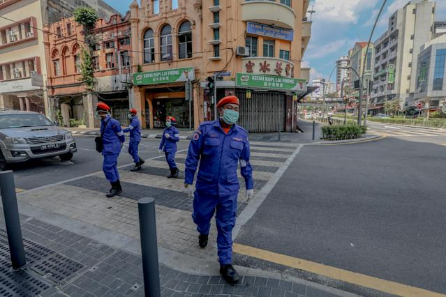 Malaysia Civil Defence Force patrol in Kuala Lumpur. The country has confirmed 1,030 COVID-19 cases so far. (Getty Images)
