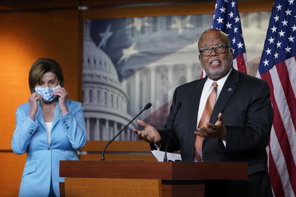 Rep. Benny Thompson, D-Miss., right, standing next to House Speaker Nancy Pelosi of Calif., left, talks to reporters on Capitol Hill in Washington, Wednesday, May 19, 2021, about legislation to create an independent, bipartisan commission to investigate the Jan, 6 attack on the United States Capitol complex. Thompson is the chairman of the House Homeland Security Committee and negotiated the bipartisan legislation. (AP Photo/Susan Walsh)