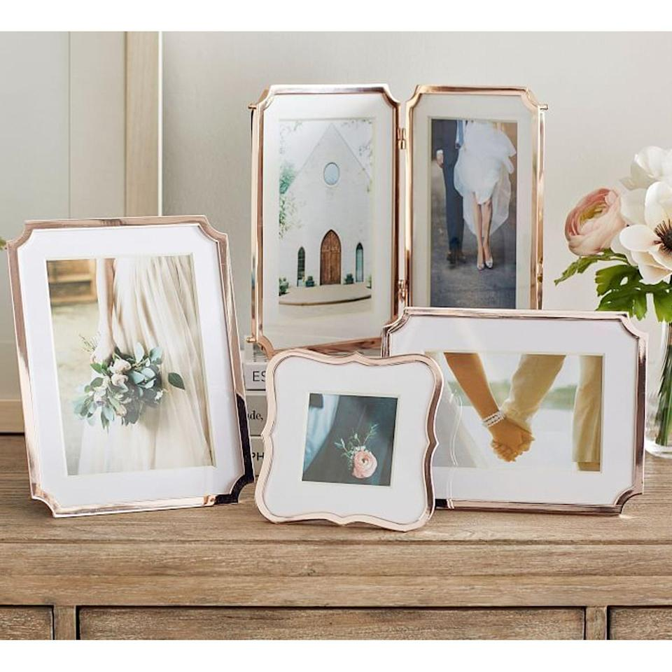 """<p><strong>Pottery Barn</strong></p><p>potterybarn.com</p><p><strong>$19.50</strong></p><p><a href=""""https://go.redirectingat.com?id=74968X1596630&url=https%3A%2F%2Fwww.potterybarn.com%2Fproducts%2Fmonique-lhuillier-marlowe-frames&sref=https%3A%2F%2Fwww.cosmopolitan.com%2Flifestyle%2Fg36905418%2Fwhere-to-buy-cheap-picture-frames%2F"""" rel=""""nofollow noopener"""" target=""""_blank"""" data-ylk=""""slk:Shop Now"""" class=""""link rapid-noclick-resp"""">Shop Now</a></p><p>Charming and traditional, these rose gold frames are meant to dress up that corner of your home.</p>"""