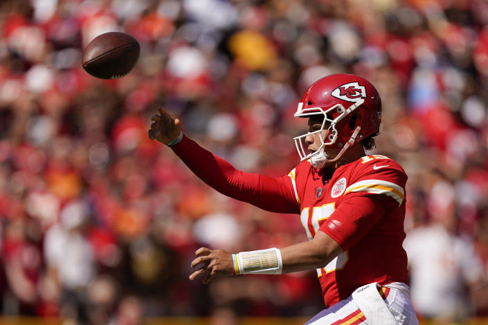 Kansas City Chiefs quarterback Patrick Mahomes (15) throws during the first half of an NFL football game against the Los Angeles Chargers, Sunday, Sept. 26, 2021, in Kansas City, Mo. (AP Photo/Charlie Riedel)