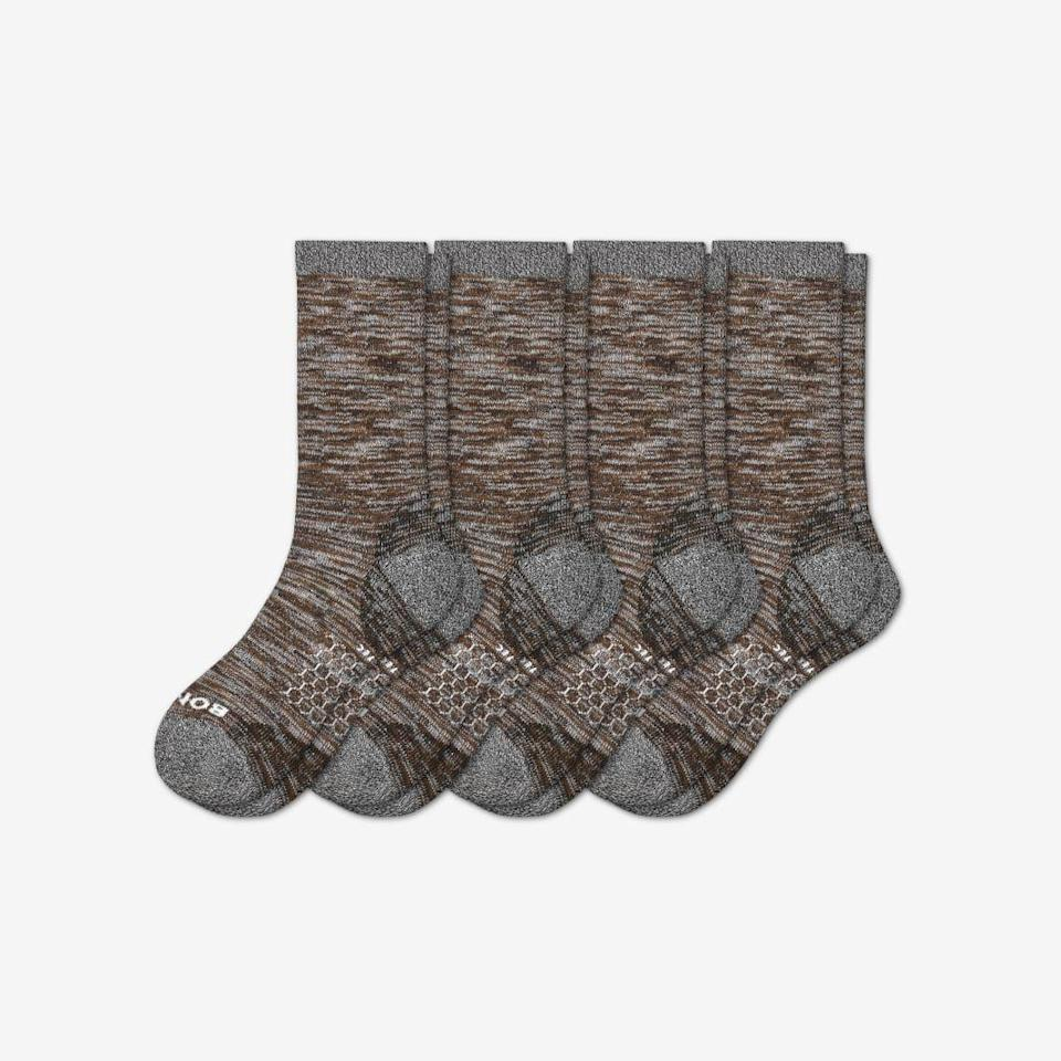 "<p><strong>Bombas</strong></p><p>bombas.com</p><p><strong>$60.80</strong></p><p><a href=""https://bombas.com/products/mens-hiking-sock-4-pack?variant=brown&campignid=8004697386&adgroupid=84095103058&targetid=pla-837038733538&network=g&device=c&creative=395461585376&gclid=CjwKCAiAnIT9BRAmEiwANaoE1TQgyqSmhTuAe2un9fBJWTpJqorPOQi5tupsK1Mw1baV3lSuwSixgBoCV2EQAvD_BwE&size=l"" rel=""nofollow noopener"" target=""_blank"" data-ylk=""slk:Buy"" class=""link rapid-noclick-resp"">Buy</a></p>"