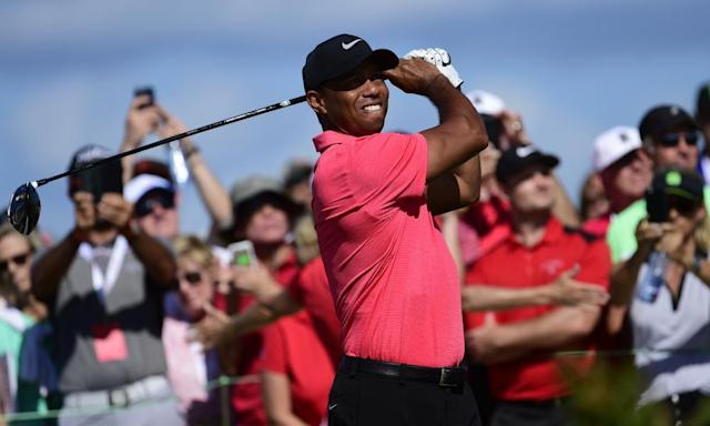 "<span class=""element-image__caption""><a class=""link rapid-noclick-resp"" href=""/pga/players/147/"" data-ylk=""slk:Tiger Woods"">Tiger Woods</a> tees off at the Hero World Challenge in the Bahamas in December. </span> <span class=""element-image__credit"">Photograph: <a class=""link rapid-noclick-resp"" href=""/soccer/players/dante/"" data-ylk=""slk:Dante"">Dante</a> Carrer/AP</span>"