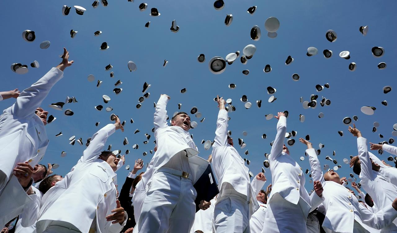 <p>Graduates toss their caps in the air upon the conclusion of the commissioning and graduation ceremony at the U.S. Naval Academy in Annapolis, Md., May 25, 2018. (Photo: Kevin Lamarque/Reuters) </p>