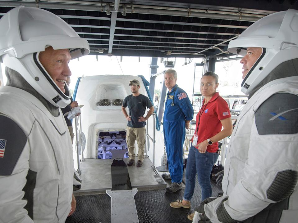 Hurley, left, and Behnken work with teams from NASA and SpaceX to rehearse crew extraction from Crew Dragon on August 13, 2019.