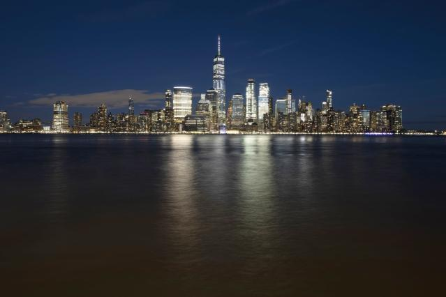 FILE - In this Dec. 28, 2018, file photo, One World Trade Center towers above the lower Manhattan skyline and the Hudson River, in New York. Big cities, like New York, aren't growing like they used to. New figures released by the U.S. Census Bureau on Thursday, May 23, 2019, show most of the nation's largest cities last year grew by a fraction of the numbers they did earlier this decade. (AP Photo/Mark Lennihan, File)