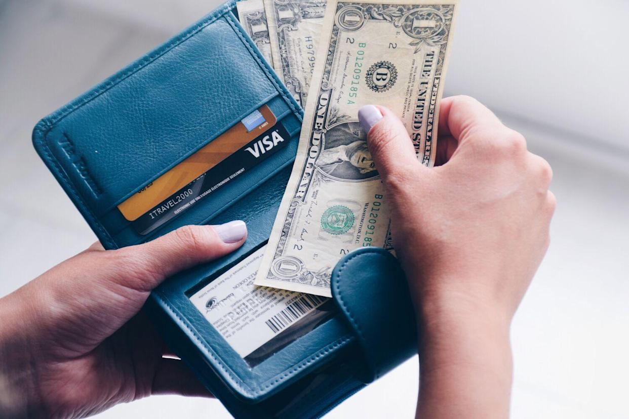 open wallet with cash and credit card