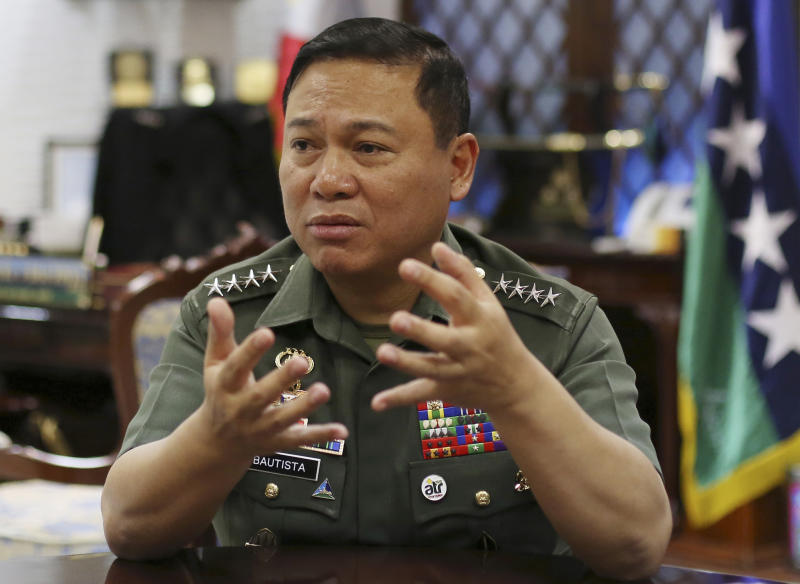 """Philippine Military Chief Emmanuel Bautista gestures during an interview at Camp Aquinaldo military headquarters in suburban Quezon city, north of Manila, Philippines on Thursday, Feb. 20, 2014. Bautista says Beijing's territorial claims in the South China Sea are """"nonsense"""" and vowed to defend fishermen if they face intimidation by Chinese naval forces in the waters. (AP Photo/Aaron Favila)"""