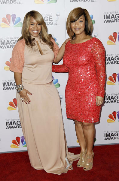 """FILE - In this Feb. 17, 2012 file photo, Erica Atkins Campbell, left, and Trecina Atkins Campbell, of gospel duo Mary Mary, arrive at the 43rd NAACP Image Awards in Los Angeles. The Grammy-winning singers, sisters Erica and Tina Campbell, offer a glimpse into the duo's lives through their new reality show, """"Mary Mary,"""" which debuts this week on WEtv. (AP Photo/Matt Sayles, file)"""