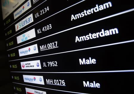 Screen showing arrival details of Malaysia Airlines flight MH17 is seen at Kuala Lumpur International Airport in Sepang