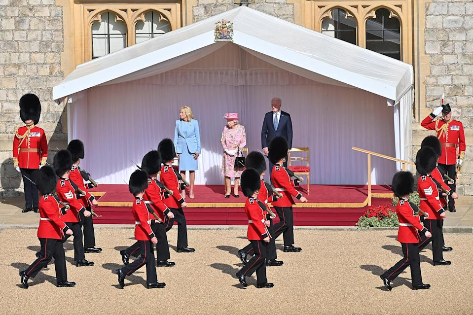 <p>The Bidens were welcomed at the dais in the Quadrangle of the castle, and a Guard of Honor formed of the Queen's Company First Battalion Grenadier Guards gave the First Couple a royal salute.</p>