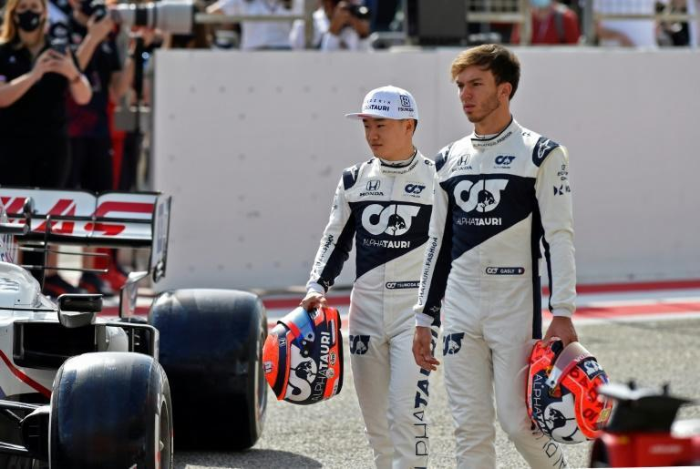 Diminutive: Yuki Tsunoda, left, at 1.59 metres (5ft 3in) is towered over by his 1.77-metre tall (5ft 9in) AlphaTauri teammate Pierre Gasly