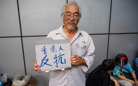 Alan Fung, 62, is taking part in a 48-hour sit-in outside the main police station on Hong Kong island - Credit: Michael Zhang