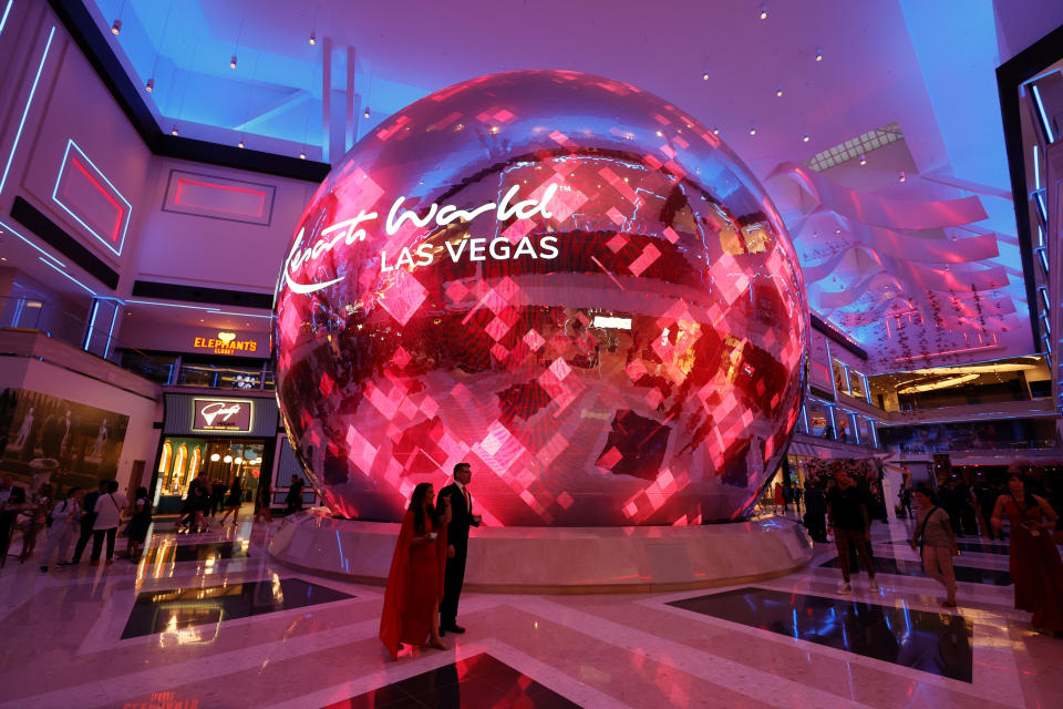 LAS VEGAS, NEVADA - JUNE 24:  Guests walk by a digital sphere during the opening of Resorts World Las Vegas on June 24, 2021 in Las Vegas, Nevada. Genting Group's property opens on the former site of the Stardust Resort & Casino and is the first new resort to be built on the Las Vegas Strip since The Cosmopolitan of Las Vegas opened in 2010. At USD 4.3 billion, it is the most expensive property ever developed in Las Vegas and features three towers with 3,500 guest rooms and suites, a 117,000-square-foot casino and a 5,000-seat theater on its nearly 88-acre site.  (Photo by Ethan Miller/Getty Images)