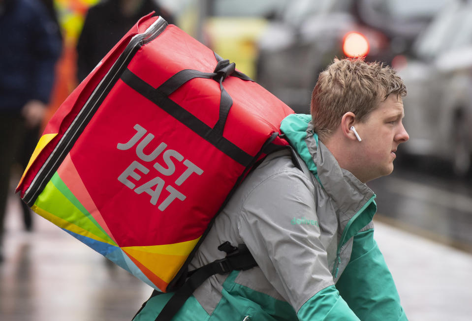 CARDIFF, UNITED KINGDOM - MAY 29: A Just Eat food delivery rider on May 29, 2019 in Cardiff, United Kingdom. (Photo by Matthew Horwood/Getty Images)