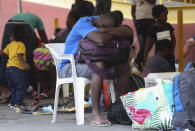 A Haitian migrant rests his head on a backpack at the Padre Infante shelter, in Monterrey, Mexico, Wednesday, Sept. 22, 2021. (AP Photo/Roberto Martinez)