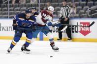 St. Louis Blues' Mike Hoffman (68) and Colorado Avalanche's Liam O'Brien (38) chase after a loose puck during the first period of an NHL hockey game Monday, April 26, 2021, in St. Louis. (AP Photo/Jeff Roberson)