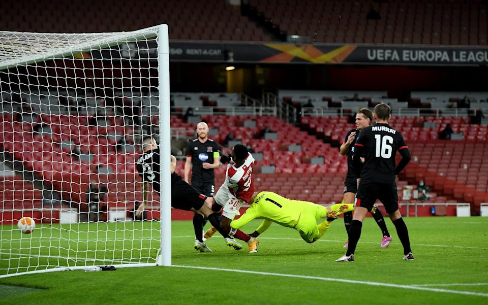 Eddie Nketiah of Arsenal scores his team's first goal during the UEFA Europa League Group B stage match between Arsenal FC and Dundalk FC at Emirates Stadium on October 29, 2020 in London, England. Sporting stadiums around the UK remain under strict restrictions due to the Coronavirus Pandemic as Government social distancing laws prohibit fans inside venues resulting in games being played behind closed doors. - Getty Images Europe
