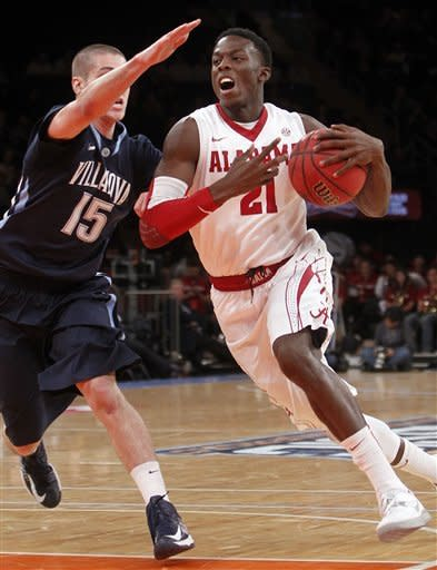 Alabama's Rodney Cooper (21) drives past Villanova's Ryan Arcidiacono (15) during the first half of an NCAA college basketball game in the final round of the 2K Sports Classic at Madison Square Garden, Friday, Nov. 16, 2012, in New York. (AP Photo/Jason DeCrow)