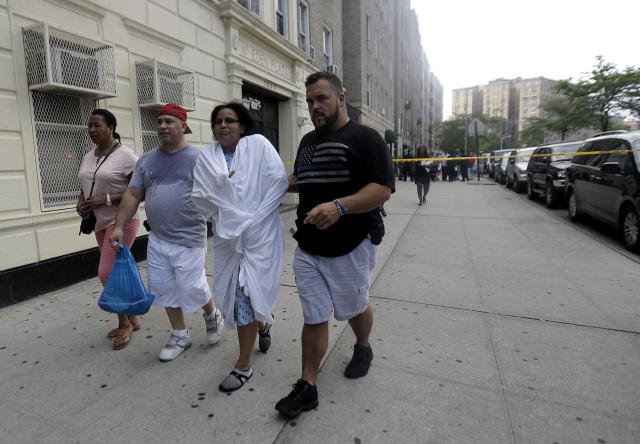 <p>A woman is escorted by officers in plainclothes near the Bronx Lebanon Hospital in New York after a gunman opened fire there on Friday, June 30, 2017. (AP Photo/Julio Cortez) </p>