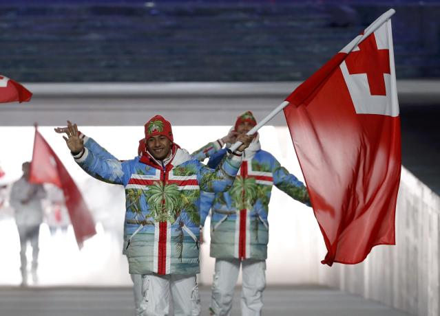 Tonga's flag-bearer Bruno Banani leads his country's contingent during the athletes' parade at the opening ceremony of the 2014 Sochi Winter Olympics, February 7, 2014. REUTERS/Phil Noble (RUSSIA - Tags: OLYMPICS SPORT)
