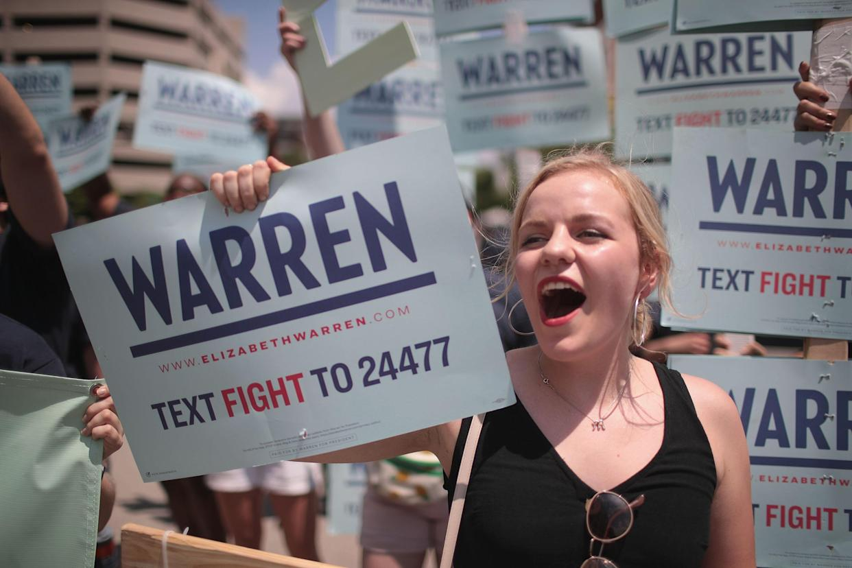 Supporters of Democratic presidential candidate Senator Elizabeth Warren (D-MA) wait for her to arrive at the Iowa Democratic Party's Hall of Fame Dinner on June 9, 2019 in Cedar Rapids, Iowa. (Photo by Scott Olson/Getty Images)