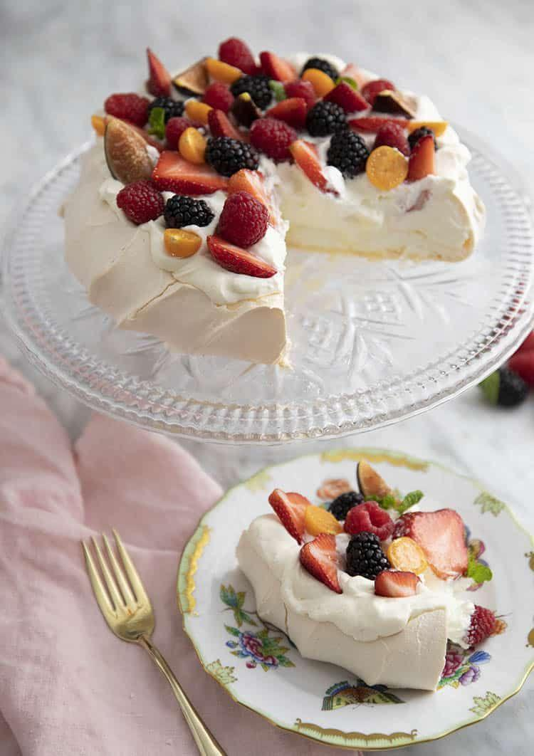 "<p>Put your baking skills to the test with this stunning pavlova that's airy, crispy, fruity, and creamy all at the same time.</p><p><strong>Get the recipe at <a href=""https://preppykitchen.com/pavlova/"" rel=""nofollow noopener"" target=""_blank"" data-ylk=""slk:Preppy Kitchen"" class=""link rapid-noclick-resp"">Preppy Kitchen</a>.</strong> </p>"