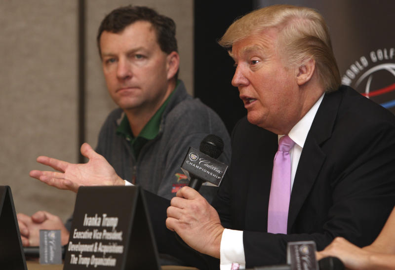 Donald Trump, right, speaks during a news conference at the Cadillac Championship golf tournament, as golf course designer Gil Hanse looks on, Thursday, March 8, 2012, in Doral, Fla. Trump purchased the Doral Hotel & Country Club, which includes four championship golf courses. (AP Photo/Lynne Sladky)