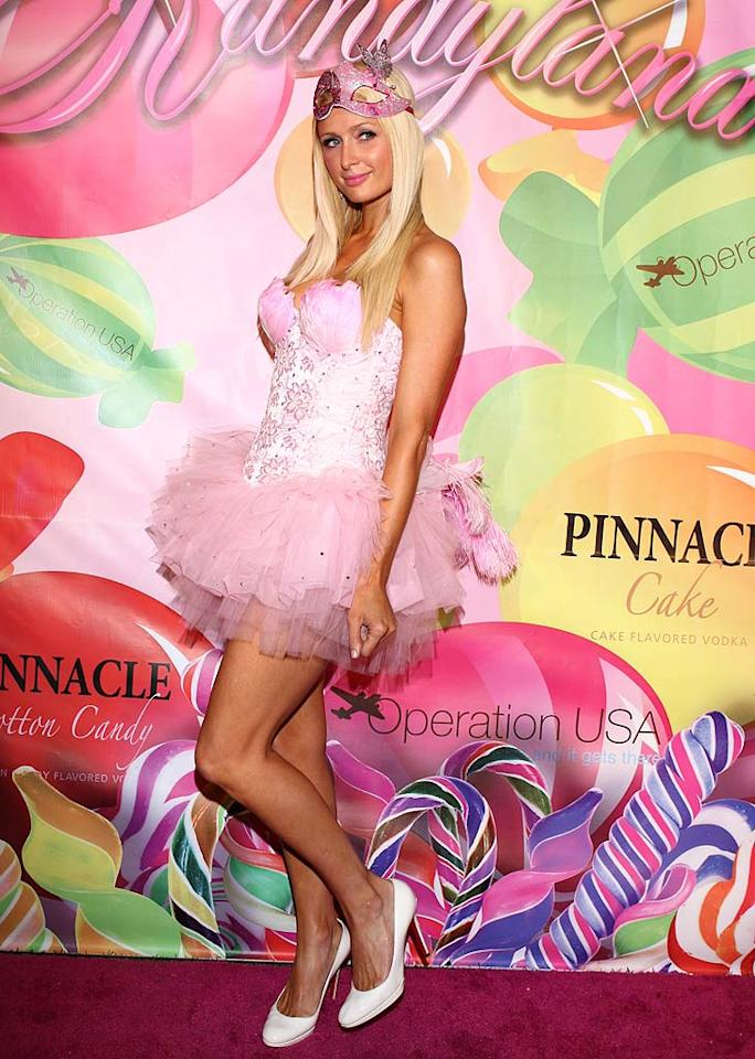 """Paris Hilton channeled her inner ballerina by donning a feather-adorned bustier and matching pink tutu for a recent fete at the Playboy Mansion. The reality TV """"star"""" paired her bubblegum-colored bomb with matronly white heels and her signature smirk. ARH/<a href=""""http://www.splashnewsonline.com"""" target=""""new"""">Splash News</a> - June 25, 2011"""