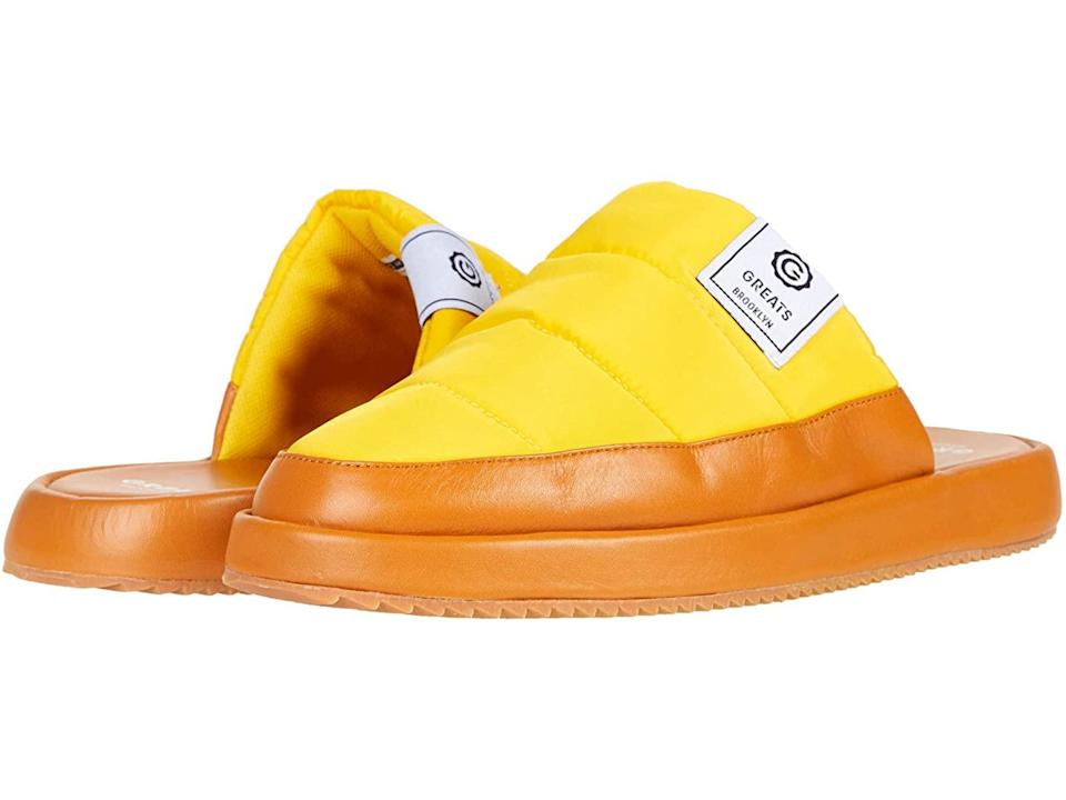 """<h2>GREATS Foster Slipper</h2><br>Yes, these shiny slides were pulled from the men's section — can you blame us? With an unmissable yellow upper, a cushy insole, and a grippy outsole, these will brighten up your interior and exterior lives.<br><br><strong>GREATS</strong> Foster Slipper, $, available at <a href=""""https://go.skimresources.com/?id=30283X879131&url=https%3A%2F%2Fwww.zappos.com%2Fp%2Fgreats-foster-slipper-yellow%2Fproduct%2F9515608%2Fcolor%2F764"""" rel=""""nofollow noopener"""" target=""""_blank"""" data-ylk=""""slk:Zappos"""" class=""""link rapid-noclick-resp"""">Zappos</a>"""