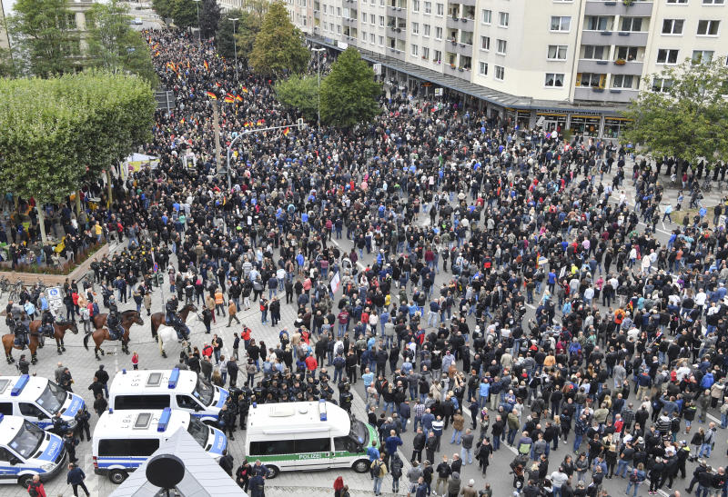 People participate in a demonstration in Chemnitz, eastern Germany, Saturday, Sept. 1, 2018, after several nationalist groups called for marches protesting the killing of a German man last week, allegedly by migrants from Syria and Iraq. (Boris Roessler/dpa via AP)