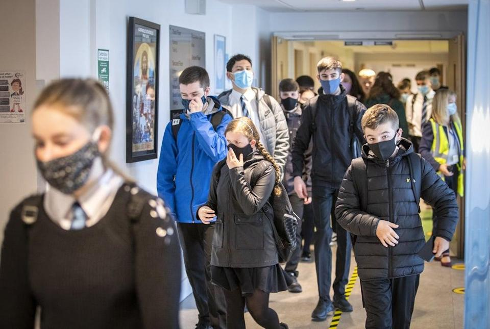 Students at St Columba's High School, Gourock, wear protective face masks as they head to lessons as the requirement for secondary school pupils to wear face coverings when moving around school comes into effect from today across Scotland. (PA Archive)
