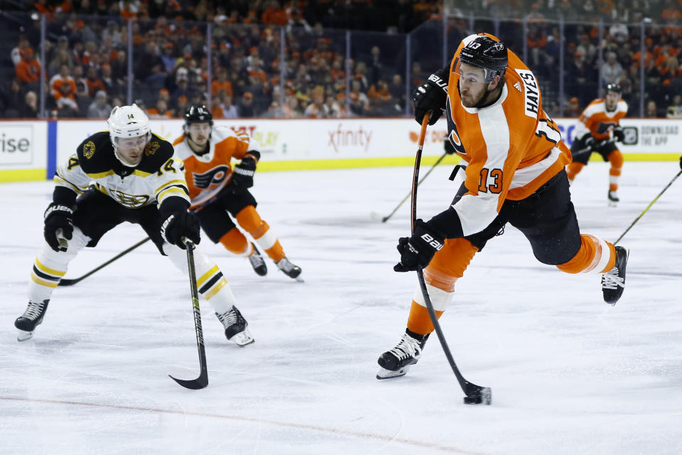 Philadelphia Flyers' Kevin Hayes, right, takes a shot past Boston Bruins' Chris Wagner during the second period of an NHL hockey game, Tuesday, March 10, 2020, in Philadelphia. (AP Photo/Matt Slocum)
