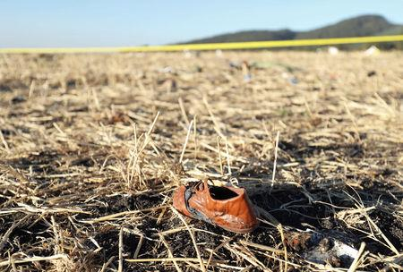 FILE PHOTO: A shoe of a passenger is seen at the scene of the Ethiopian Airlines Flight ET 302 plane crash, near the town of Bishoftu, southeast of Addis Ababa, Ethiopia March 10, 2019. REUTERS/Tiksa Negeri