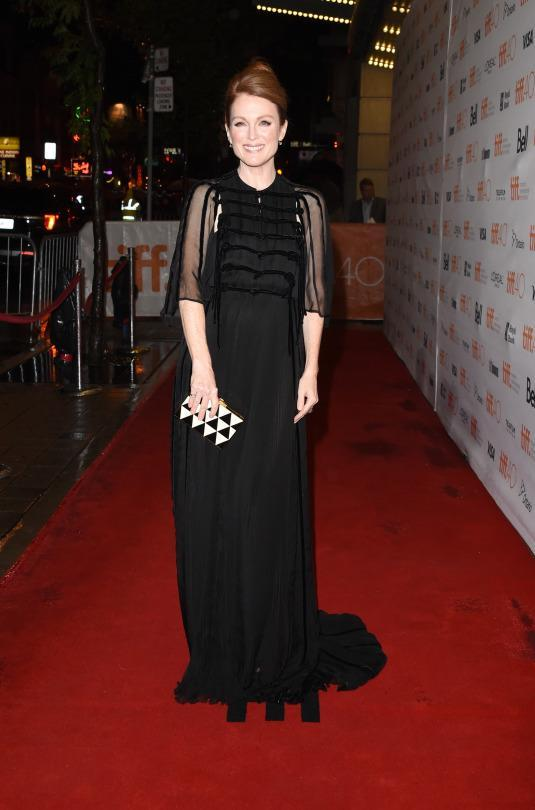 "<p>Julianne Moore attended the ""Maggie's Plan"" premiere in a Valentino gown. From the Fall 2015 Couture collection, the gown featured ruffles and sheer sleeves.</p>"