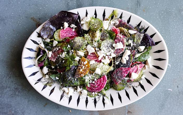 """To prep this salad ahead (there's a lot of slicing involved), hold beets and scallions in a bowl of cold water with a splash of vinegar, which both seasons them and maintains crunch. <a href=""""https://www.bonappetit.com/recipe/raw-beet-and-cucumber-salad?mbid=synd_yahoo_rss"""" rel=""""nofollow noopener"""" target=""""_blank"""" data-ylk=""""slk:See recipe."""" class=""""link rapid-noclick-resp"""">See recipe.</a>"""