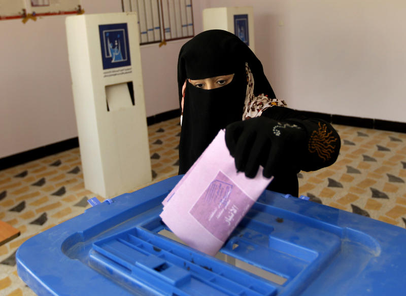 An Iraqi woman casts her ballot at a polling center during the country's provincial elections in Fallujah, Iraq, Thursday, June 20, 2013. Iraqis in two Sunni-dominated provinces voted Thursday in provincial elections marked by tight security measures that left streets in former insurgent strongholds largely deserted. (AP Photo/ Khalid Mohammed)