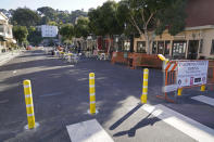 A street blocked off for outdoor dining is mostly empty Friday, Dec. 4, 2020, in Sausalito, Calif. The health officers in six San Francisco Bay Area regions have issued a new stay-at-home order as the number of virus cases surge and hospitals fill. The changes announced Friday will take effect in most of the area at 10 p.m. Sunday and last through Jan. 4. It means restaurants will have to close to indoor and outdoor dining, bars and wineries must close along with hair and nail salons and playgrounds. (AP Photo/Eric Risberg)