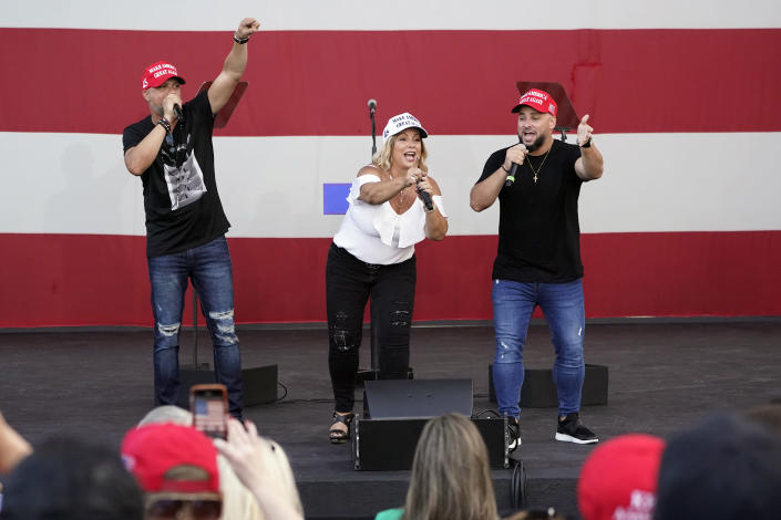 "FILE- In this Tuesday, Oct. 27, 2020 file photo, members of the Cuban musical group Los 3 de La Habana, German Pinelli, left, Ana Paez, center, and Tirso Luis, right, sing during a ""Make America Great Again!"" event with Ivanka Trump at Bayfront Park Amphitheater, in Miami. Florida's Cuban American voters remain a bright spot in Trump's effort to retain his winning coalition from 2016. Polls show his strong support from these key voters may even be growing to include the younger Cuban Americans that Democrats once considered their best hope of breaking the GOP's hold. The musicians say Trump's economic and foreign policies have been his main achievements. (AP Photo/Wilfredo Lee, File)"
