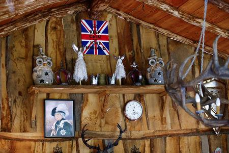 """An oil painting of the Queen Elizabeth is pictured in """"Robin Hood's hut"""" at the British curiosities collection """"Little Britain"""" of Gary Blackburn, a 53-year-old tree surgeon from Lincolnshire, Britain, in Linz-Kretzhaus, south of Germany's former capital Bonn, Germany, August 24, 2017. REUTERS/Wolfgang Rattay"""