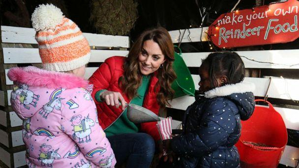 PHOTO: Catherine, Duchess of Cambridge hands out reindeer food to children during a visit to Peterley Manor Farm on Dec. 4, 2019 in Great Missenden, England. (Wpa Pool/Getty Images)