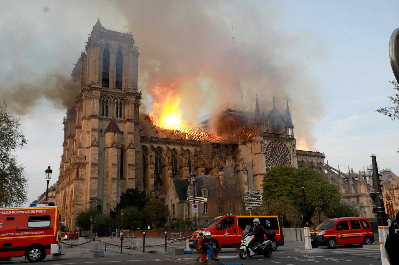 <p>Flames and smoke are seen billowing from the roof at Notre Dame Cathedral April 15, 2019 in Paris, France. (Photo by Pierre Suu/Getty Images) </p>