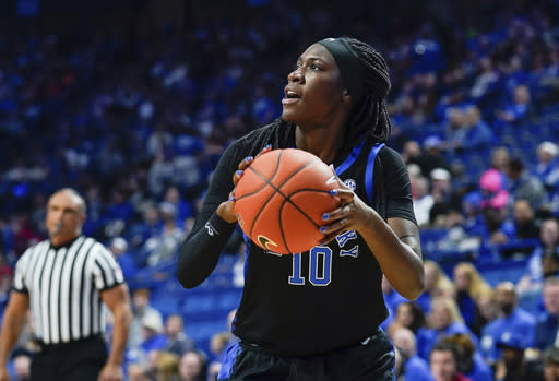 FILE - In this Dec. 15, 2019, file photo, Kentucky guard Rhyne Howard (10) looks to shoot against Louisville during an NCAA college basketball game in Lexington, Ky. Howard is rewriting the record books at Kentucky and she's only a junior. Now the Wildcats star is the first player from the school to be honored as a preseason All-American by The Associated Press. Howard was a unanimous choice from the 30-member national media panel Thursday, Nov. 12. (AP Photo/Bryan Woolston, File)