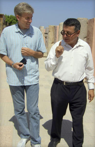 In this photo posted on the U.S. Embassy Tripoli Facebook page on Aug. 27, 2012, U.S. Ambassador to Libya Christopher Stevens, left, walks with an unidentified translator during a tour of Assaraya al-Hamra, or the Red Castle in Tripoli, Libya. Libyan officials say the U.S. ambassador and three other Americans have been killed in an attack on the U.S. consulate in the eastern city of Benghazi by protesters angry over a film that ridiculed Islam's Prophet Muhammad. (AP Photo/U. S. Embassy Tripoli)