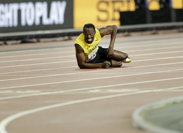 2017 AP YEAR END PHOTOS - Jamaica's Usain Bolt lies on the track after he injured himself during the 4x100 m relay final at the World Athletics Championships in London on Aug. 12, 2017. (AP Photo/Tim Ireland)