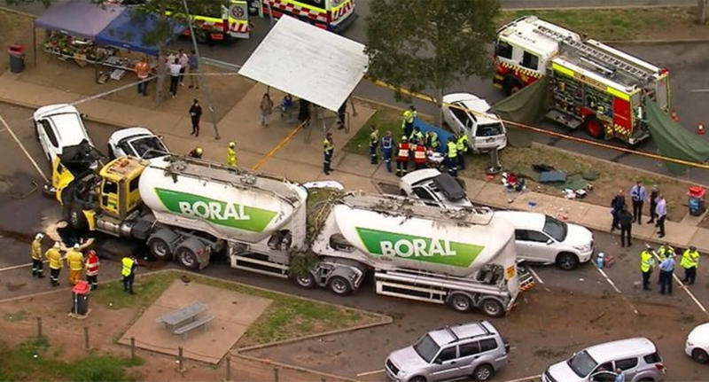 Paramedics and firefighters attend the scene of a crash in Menangle.