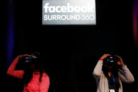 Attendees use Oculus virtual reality headset during the annual Facebook F8 developers conference in San Jose